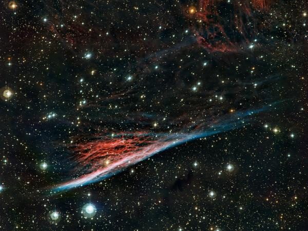 "Just the tiniest slice of what's out there: the Pencil Nebula is pictured in an image from the European Southern Observatory's La Silla facility in Chile. This peculiar cloud of glowing gas is part of a huge ring of <a href=""http://www.eso.org/public/news/eso1236/"">wreckage left over after a supernova explosion</a> that took place about 11,000 years ago."