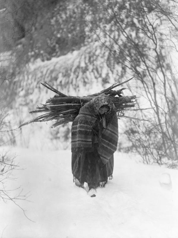<em>A Heavy Load—Sioux,</em> 1908. Curtis tried to record scenes of the hard life of a winter on the northern plains.