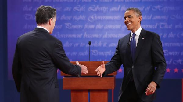 President Obama and Republican challenger Mitt Romney greet one another before Wednesday's debate in Denver.