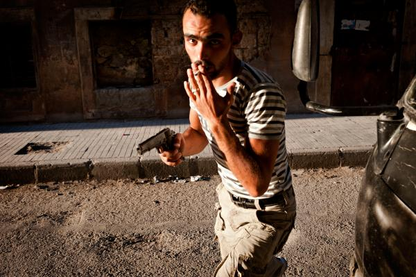 A Free Syrian Army fighter in the Bustan Pasha neighborhood of Aleppo, Syria, Aug. 21.