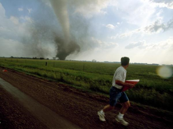 A storm chaser (a kind of weather scientist) places a probe in the path of a tornado in South Dakota.