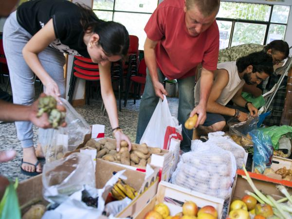 In June, people in Madrid came to a distribution center where those in need could get food.