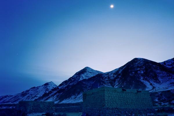 Photographed at dusk, the mud-and-thatch house of Jimira, the third daughter of the Kuruman family, is situated high in the Tianshan mountains.