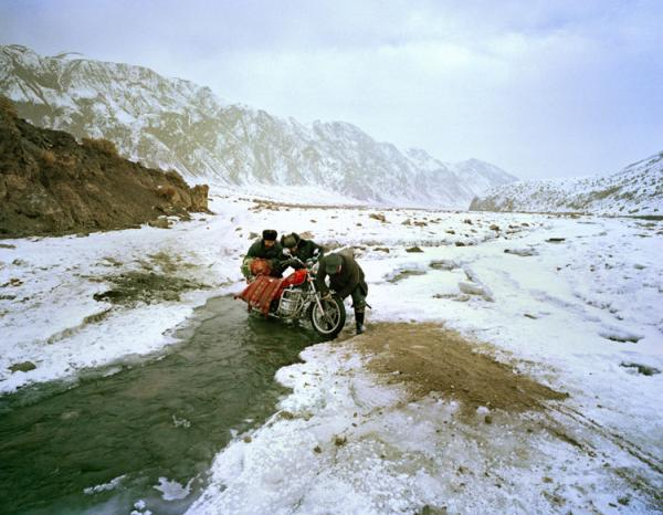 By motorcycle, the trip from the mountains to the town of Wuqiaxian takes 9 1/2 hours through a snowy valley.
