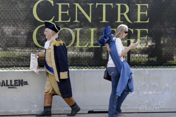Paul Johnson, dressed as George Washington, walks past a barricade at the liberal arts school.