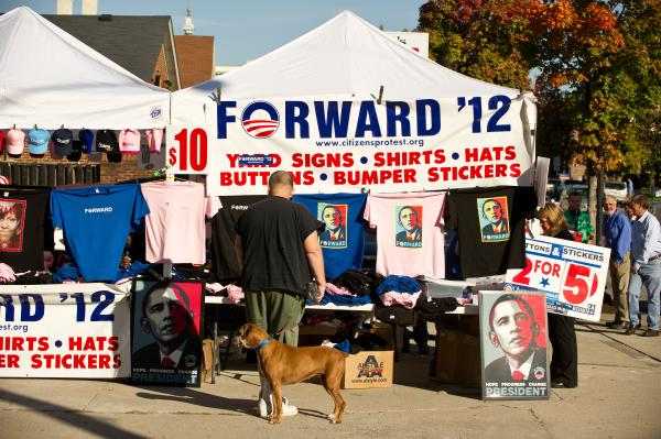 A man walking his dog looks at Obama merchandise for sale in Danville.