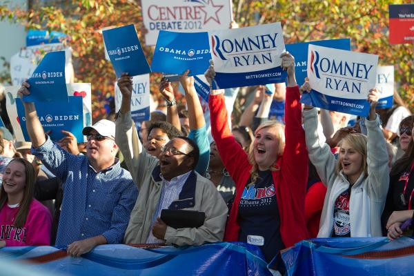 Supporters of both President Obama and Mitt Romney cheer outside the debate.