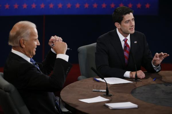 Biden gestures while Ryan speaks during the debate. There was sharp disagreement on the attack in Libya and what it symbolizes.