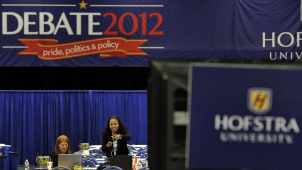 Media sets up in Spin Alley as they prepare for the debate between Republican presidential candidate Mitt Romney and and President Barack Obama.
