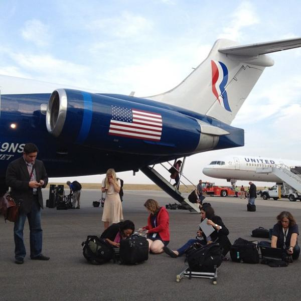 "Campaign reporters file their stories on the tarmac in Denver after Mitt Romney took questions in flight. <a href=""http://web.stagram.com/p/287087759302084703_13901041"">@charlesdharapak<strong><br /></strong></a>"