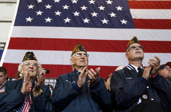 Veterans applaud at an Oct. 8 campaign event in Swanton, Ohio, for Republican vice presidential candidate Paul Ryan. Health care and unemployment are among veterans' chief concerns this election season, and both the Obama and the Romney campaigns have offered solutions.