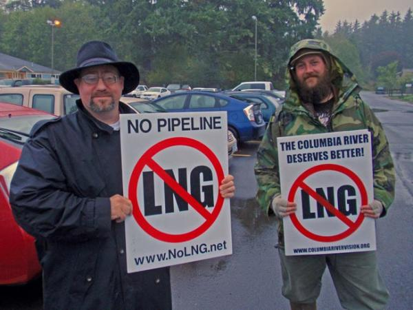 Portland attorney Robert Lorey (left) and Astoria marine biologist Dave Lillis protest natural gas exports outside the Warrenton Community Center. Photo by Tom Banse
