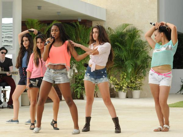 Girl group Lylas performs in front of Simon Cowell and guest mentor Marc Anthony on <em>The X Factor</em>.