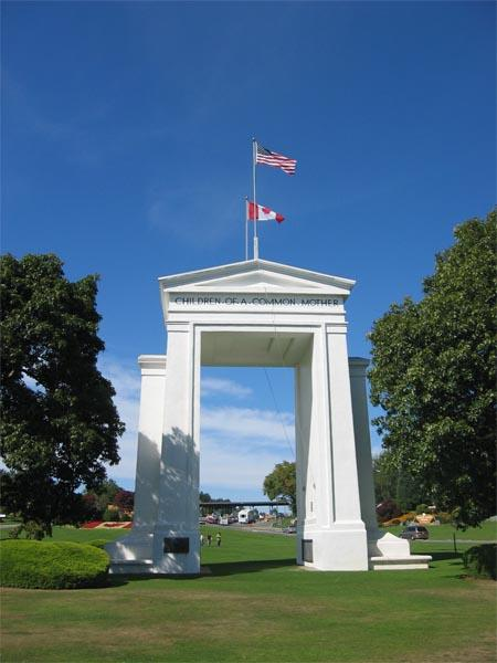 The Peace Arch stands exactly on the US – Canadian border in the grass median between the northbound and southbound lanes of I-5 and Highway 99. Photo by Arnold C via Wikimedia Commons