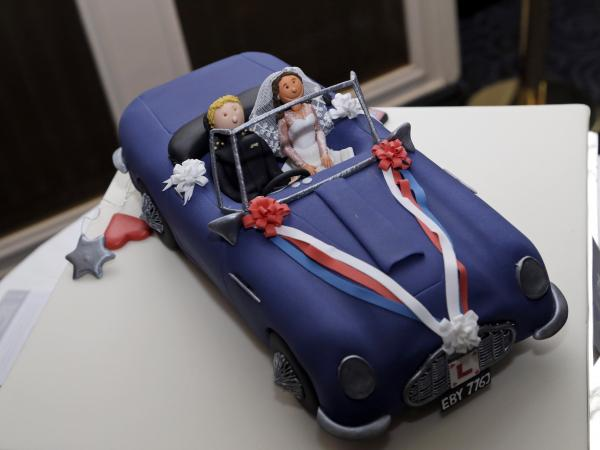 A special cake re-enacting the scene of Prince William, Duke of Cambridge's wedding in 2011 where he drove the car with his wife the Catherine, Duchess of Cambridge, as he attends a reception prior to the annual October Club dinner in aid of the St Giles Trust on Wednesday night.