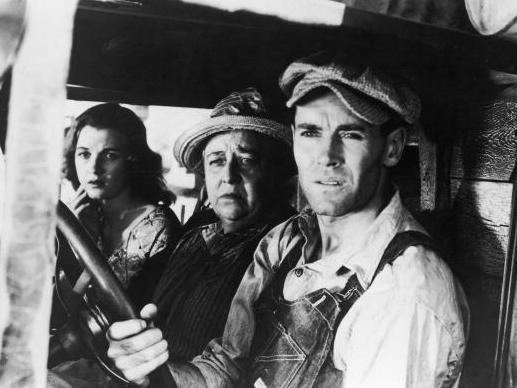 Actors (from left) Dorris Bowdon, Jane Darwell and Henry Fonda in a still from the 1940 film <em>The Grapes of Wrath,</em> directed by John Ford.