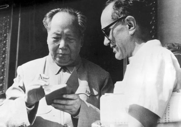 Mao Zedong signs Sidney Rittenberg's copy of <em>The Little Red Book</em> during a gathering of party leaders in Beijing on May 1, 1967, at the beginning of China's Cultural Revolution.