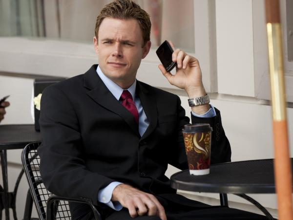 Bradley Snedeker is the actual name of this actor in <em>I Married Who? </em>He plays Kellie Martin's fiance. He is getting The Pullman, and you can tell from this photo. (See how he's on his phone all the time?)