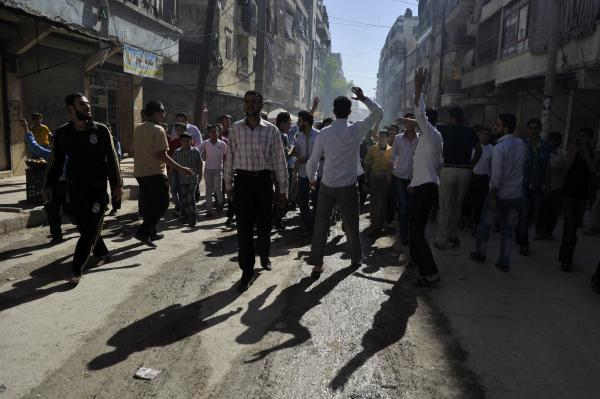 Syrian protesters shout slogans during an anti-regime demonstration in the northern city of Aleppo on Friday.