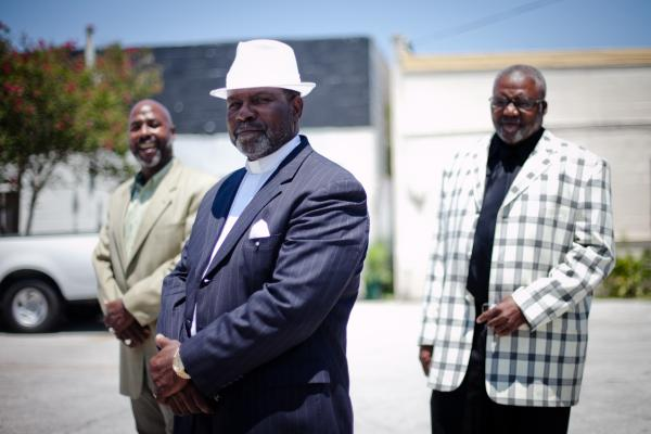 Ministers Anthony Davis (from left), Eddie Walker and James Major stand outside In Lord's Time Tabernacle Church in downtown Orlando. All three are convicted felons now working to get their civil rights restored.
