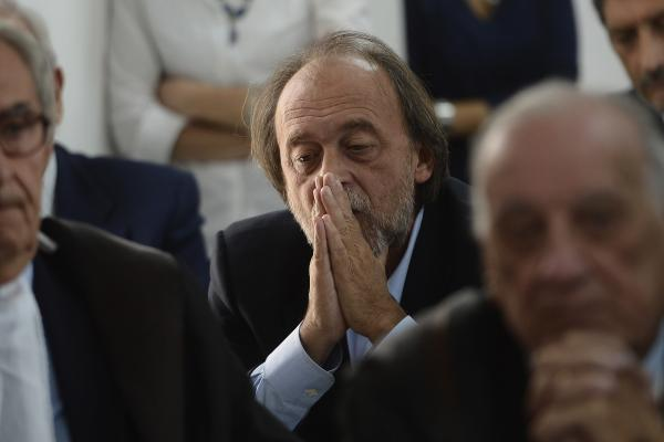 One of the indicted, Bernardo De Bernardinis, who was deputy chief of Italy's Civil Protection Department, reacts during a his trial.