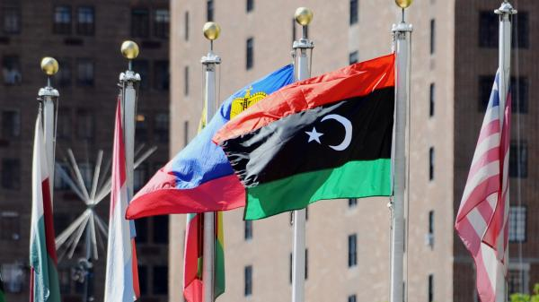 The flag of Libya's National Transitional Council (second from right) flies outside the United Nations headquarters building in New York.