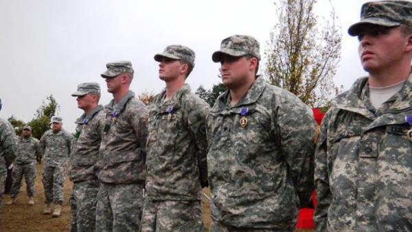 Five Washington-based soldiers with brain injuries were awarded the Purple Heart at a ceremony at Joint Base Lewis-McChord. Photo by Austin Jenkins