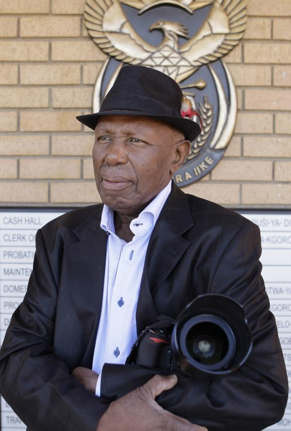 Alf Kumalo, a celebrated South African photographer, died Sunday of prostate cancer in Soweto. He was 82. Here, he is seen in April outside the Magistrate Court in Johannesburg, while pursuing a hate speech case against a white man he accused of attacking him with a racial slur.