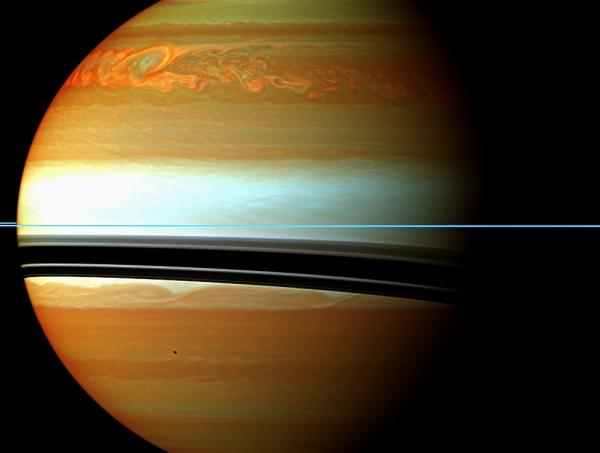 These red, orange and green clouds (false color) in Saturn's northern hemisphere indicate the tail end of the massive 2010-2011 storm. Even after visible signs of the storm started to fade, infrared measurements continued to reveal powerful effects at work in Saturn's stratosphere.