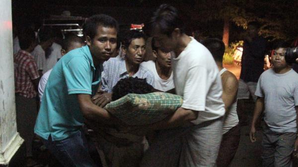 An injured Rakhine Buddhist is taken to the hospital following violence in Rakhine state, Myanmar.