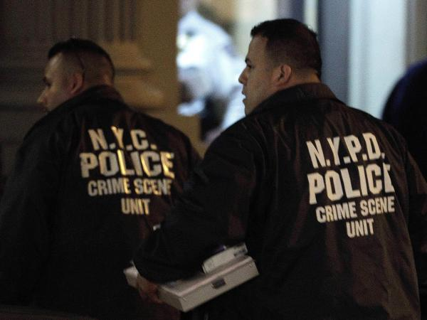 Crime scene unit officers outside the Manhattan apartment building where the children were killed Thursday.