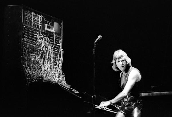 <strong>I think we can all agree that he deserves at least a little bit of the blame:</strong> Keith Emerson of Emerson, Lake & Palmer on stage with his Moog synthesizer.