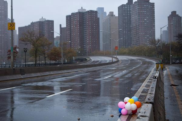 Balloons lie on the side of a closed New York City street Monday.