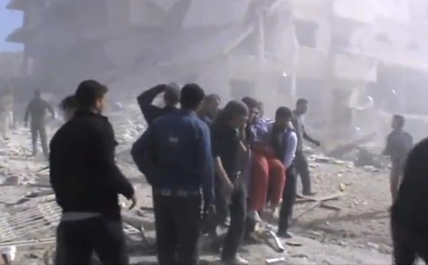 An image taken from video obtained from the Shaam News Network, authenticated by AP reporting, shows attempts to rescue the wounded in Idlib, northern Syria following heavy bombing from military warplanes.