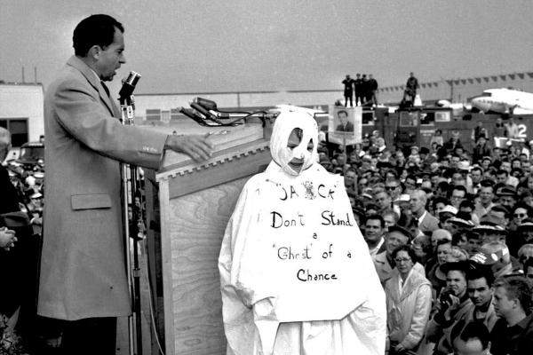 "Richard Nixon addresses a crowd while campaigning for president against John F. Kennedy in 1960. To his right is 10-year-old Tom Lemke, in a ghost costume that reads ""Jack Don't Stand a Ghost of a Chance,"" referring to Kennedy. Nixon called attention to the boy when he saw him in the crowd. So, moral of the story: Wearing a costume can make you famous."