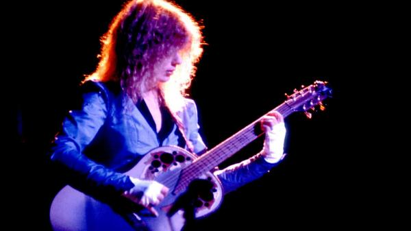 Heart's Nancy Wilson onstage in 1983, looking very Jimmy Page.