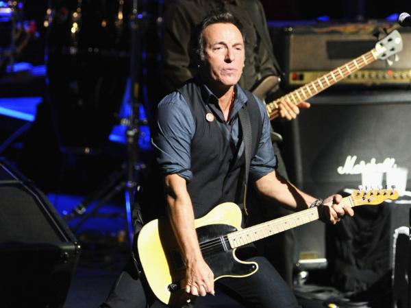 "Bruce Springsteen and the retooled E Street Band ripped through a nearly three-hour ""secret"" concert at the Moody Theater, the new home of <em>Austin City Limits</em>, during SXSW. Ever the showman, Springsteen crowd-surfed."