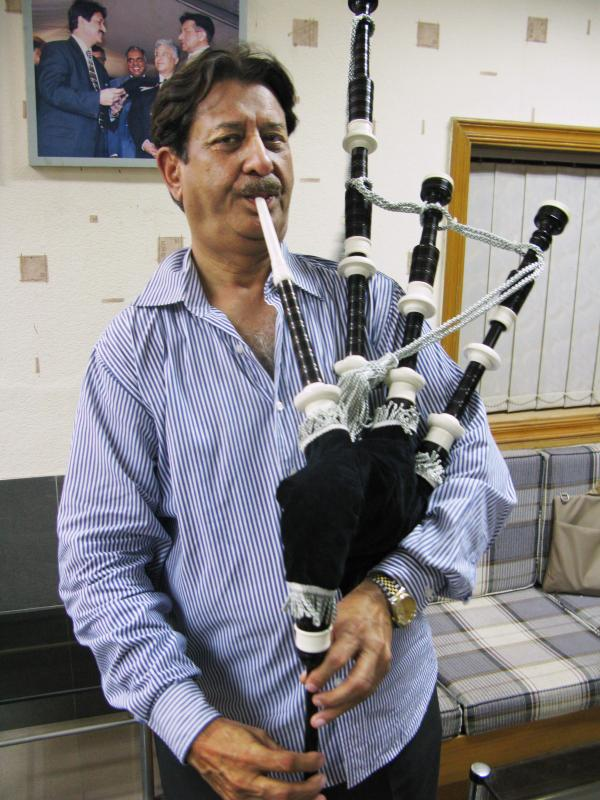 Naeem Akhbar is chief executive of Halifax and Co., a more than 70-year-old bagpipe manufacturer in Sialkot. Here, he plays the most expensive bagpipe his company produces, which sells for $700 in Pakistan and more than $1,600 in Europe and the U.S.