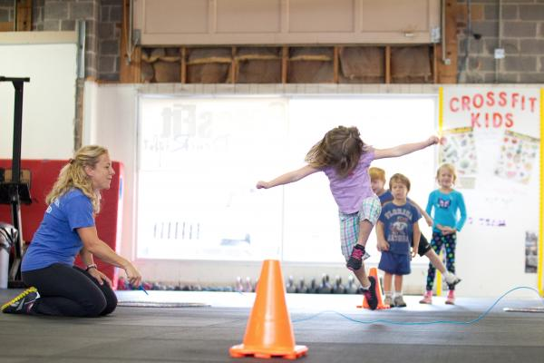 "The CrossFit class for kids in Rockville, Md., includes an exercise called ""jump the snake."" Tavi Decker, 4, demonstrates."