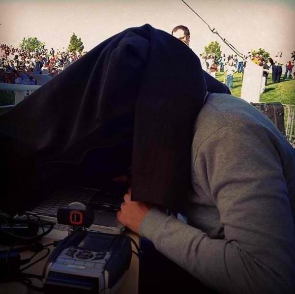 "Reporting From the Campaign Trail: NPR Correspondent Ari Shapiro covers his head with a coat to block out noise and distraction as he talks with Host Audie Cornish on <em>All Things Considered</em>. <a href=""http://bit.ly/RxHc6r"">http://bit.ly/RxHc6r </a>"