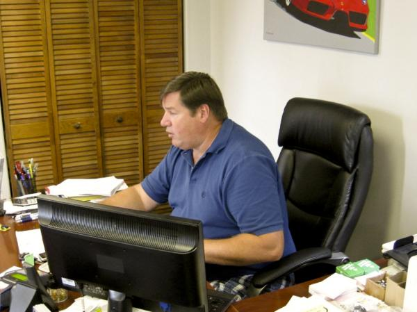 When Phil Luby was laid off in late 2008, he decided to become an entrepreneur and open a used car lot.