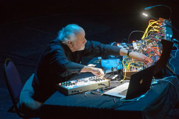 Morton Subotnick works the controls for a synthesizer originally designed by Don Buchla in the 1960s. Subotnick used a similar one to record <em>Silver Apples of the Moon.</em>
