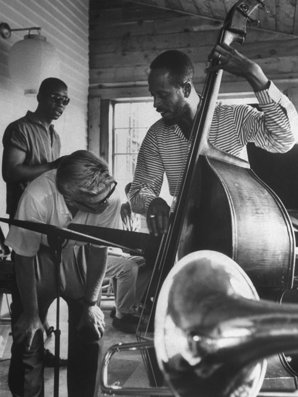 Bassist Percy Heath demonstrates a technique to a student at the summer jazz workshop in Lenox, Mass. in 1959.