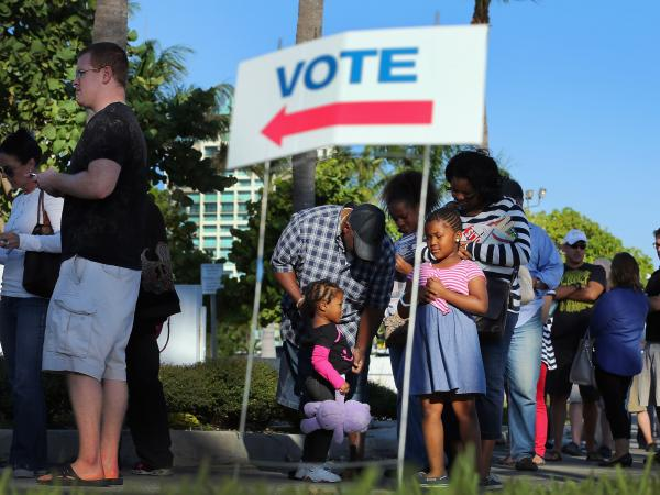 Early voters waited in line Wednesday in Miami.