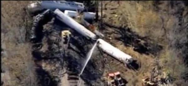 A train carrying chemicals derails outside Louisville, Ky. and a fire breaks out, badly injuring three workers on Thursday, Nov. 1