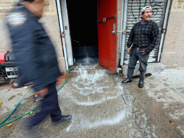 Water was being pumped out of this business in Manhattan's East Village on Thursday.