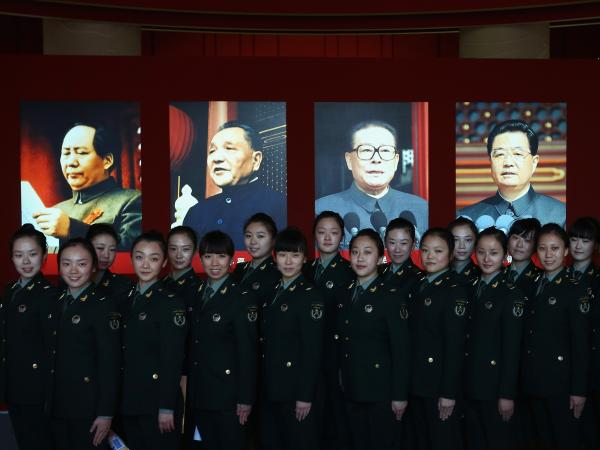 Soldiers pose in front of portraits of China's top Communist leaders (from left, Mao Zedong, Deng Xiaoping, Jiang Zemin and President Hu Jintao) at an exhibit before the 18th National Congress of the Communist Party of China, scheduled to begin Thursday in Beijing. China's next leader will be unveiled at the congress.