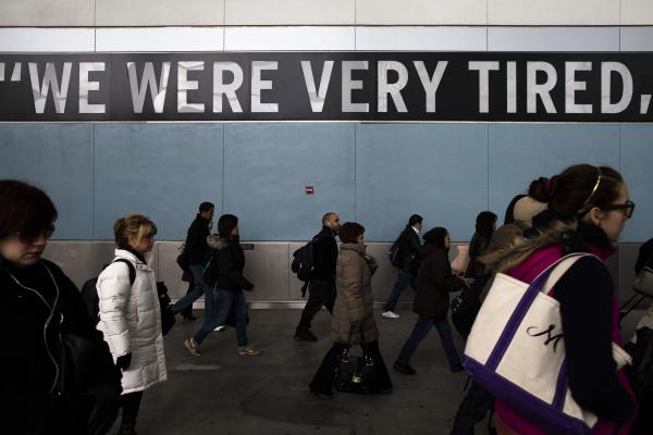 Commuters disembark the Staten Island Ferry one week after Superstorm Sandy crashed into the metropolitan area.