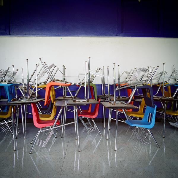 School desks are piled on top of each other at the shuttered H.S. Thompson Elementary School in Dallas. Thompson was one of 11 schools closed by the Dallas Independent School District in 2012.