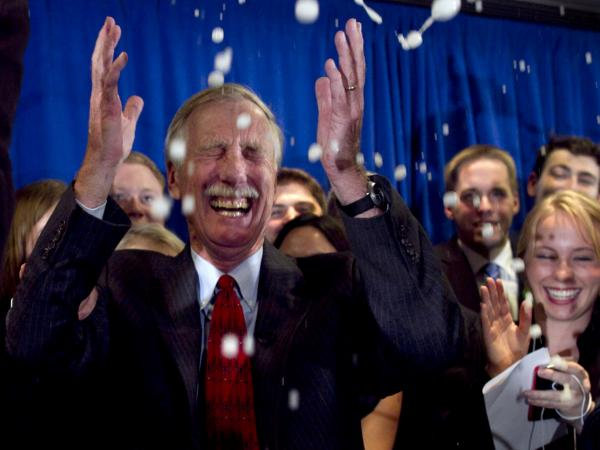Independent Angus King celebrates under a splash of champagne in Freeport, Maine, on Tuesday after winning the Senate seat vacated by Republican Olympia Snowe.